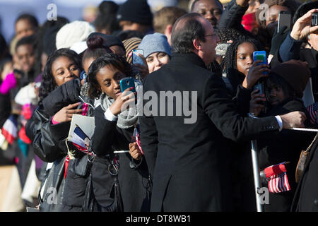 Washington, DC, USA. 11th Feb, 2014. Attendees take photographs of President Francois Hollande of France during - Stock Photo