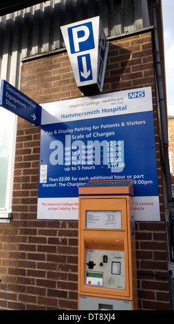 united kingdom west london du cane road hammersmith hospital a sign displaying car parking charges - Stock Photo