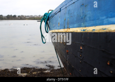 Wooden boat on the rocky beach - Stock Photo