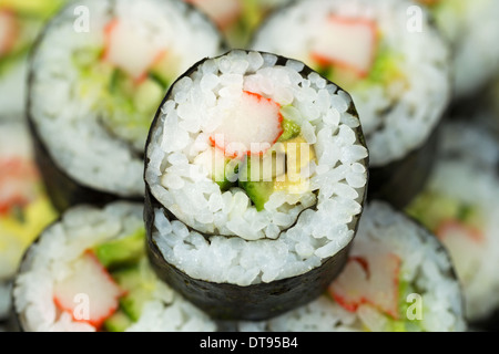 Extreme horizontal Closeup photo of a single California hand roll sushi with focus in center - Stock Photo