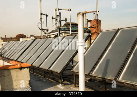 Solar thermal panels on the top of public housing in the Bronx, New York. - Stock Photo