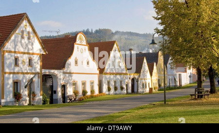 Rustic houses on the small village of Holasovice, South Bohemia, Czech Republic. - Stock Photo