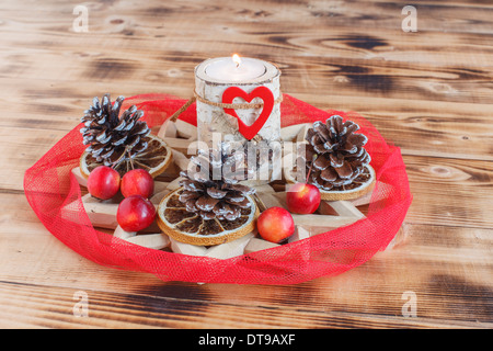 Advent wreath with red stripes wrap around candle holders made of Birch wood - Stock Photo