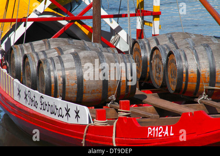 Barrels of port wine on the Douro River, Porto. - Stock Photo