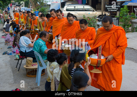 Buddhist monks on their morning alms round on the first day of the new year, Lao New Year (Pi Mai Lao), Luang Prabang, - Stock Photo