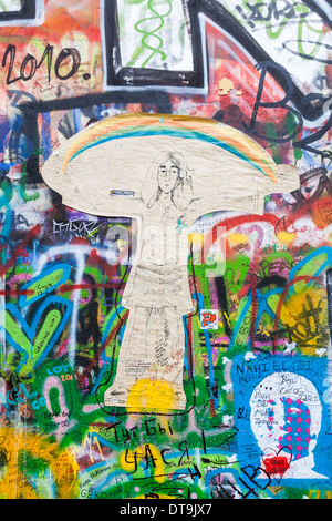 The iconic John Lennon Wall memorial in the Little Quarter, Prague, Czech Republic covered with colourful tribute - Stock Photo