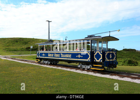 Tourists taking a ride on the Great Orme Tramway on top of the hill in the scenic seaside town of Llandudno, North - Stock Photo