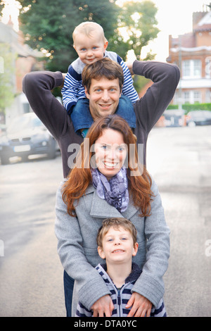 Family of Four Standing one behind the other - Stock Photo