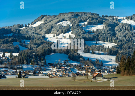 Village of Le Paquier in the wintery Fribourg Pre-Alps, near Bulle, Canton of Fribourg, Switzerland - Stock Photo