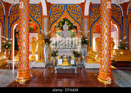Buddhist altar and ornate columns, Wat Chalong temple, Phuket, Thailand - Stock Photo
