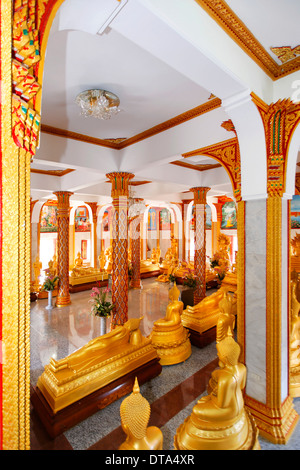 Room with golden Buddha statues, Wat Chalong temple, Phuket, Thailand - Stock Photo