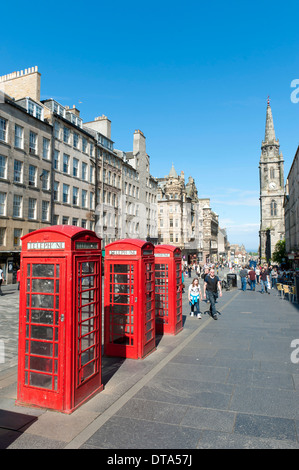 Red telephone booths in the historic centre, Royal Mile, pedestrianised high street, The Tron Kirk church at the - Stock Photo