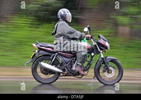 Motorcycle in heavy rain, Sri Lanka - Stock Photo