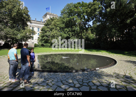 Berlin, Germany, passers-by on the Sinti and Roma Memorial in Berlin-Tiergarten - Stock Photo
