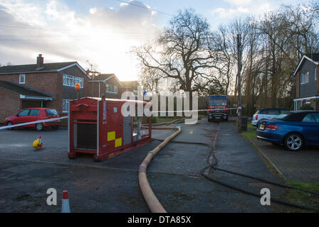 Marlow, UK. 13th Feb, 2014. A High Volume Pump (HVP) has been drafted in from the Staffordshire Fire and Rescue - Stock Photo