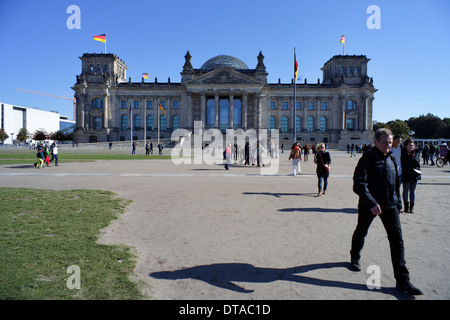 Berlin, Germany, passers-by on the Republic Square in front of the Reichstag - Stock Photo