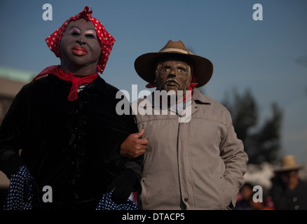 Two dancers wearing masks perform the Dance of the Elderly or Danza de los Viejitos at the Our Lady of Guadalupe - Stock Photo
