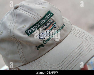 4f53387a05c Man wearing a baseball cap embroidered Jeep Grand Wagoneers. Vehicle  advertising material - Stock Photo