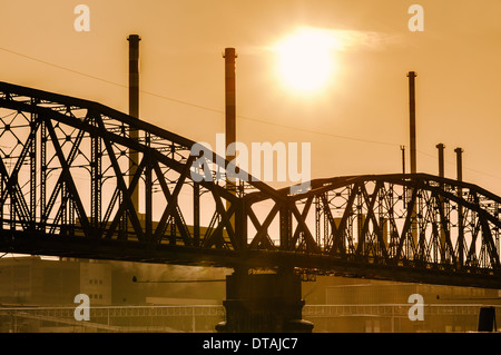 Bridge and industrial buildings on late Afternoon