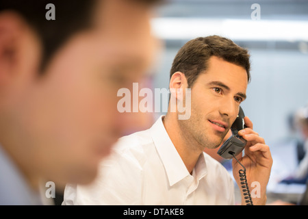 Businessman on the phone at the office - Stock Photo