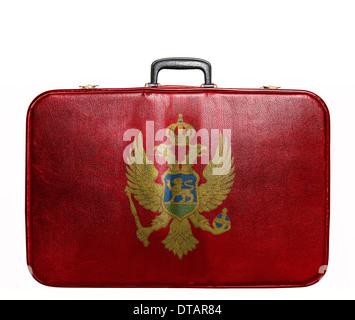 Vintage travel bag with flag of Montenegro - Stock Photo