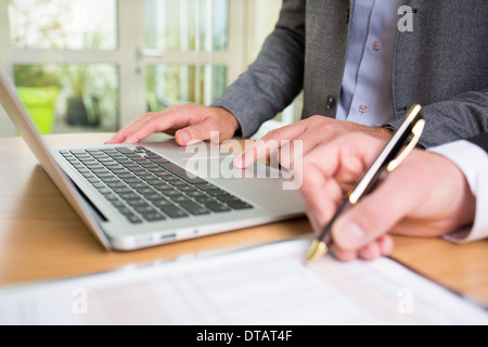 Closeup of Two hands businessmen working together in office with laptop - Stock Photo