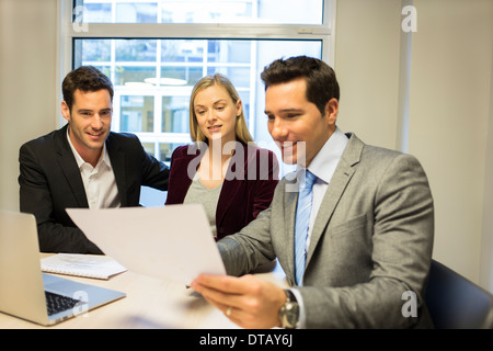 Real-estate showing contract at young couple, new property owners - Stock Photo