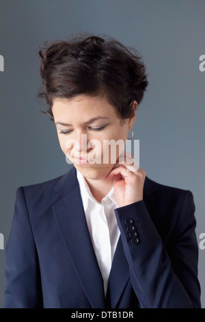 Mid adult woman making funny face, close-up - Stock Photo
