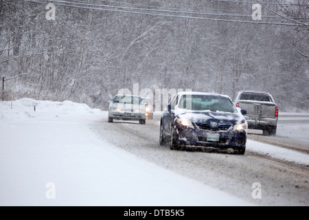 traffic moving during a winter storm in Vermont - Stock Photo
