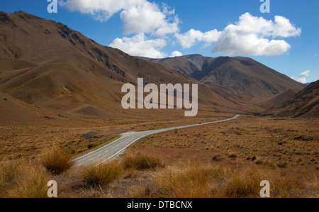 Road on Lindis Pass, near Omarama, Southern Alps, South Island, New Zealand - Stock Photo