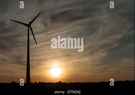Nauen, Germany , wind turbine on a field in the evening sun - Stock Photo