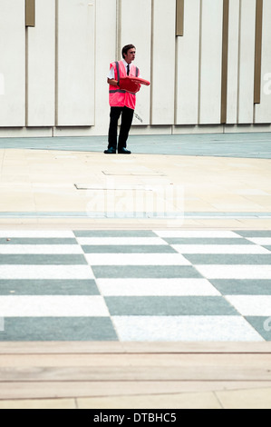 Steward Is Standing To Help Visitors To Go To The Olympic London 2012 Olympic Park, in Westfield shopping Center, Stratford