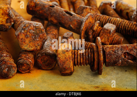 Old rusty bolt and nuts - Stock Photo