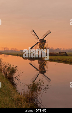Drainage mill ''Hope springs eternal'' at sunrise in Voorhout, South Holland, The Netherlands - Stock Photo