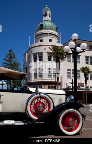 Art Deco buildings and vintage car in Napier, North Island, New Zealand - Stock Photo