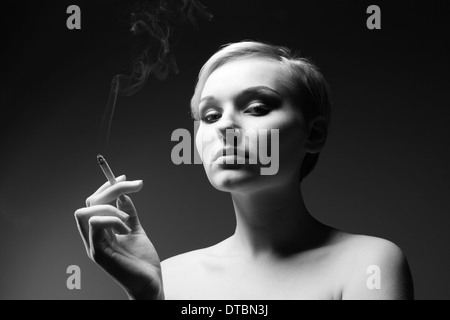 Black and white portrait of a woman with cigarette - Stock Photo