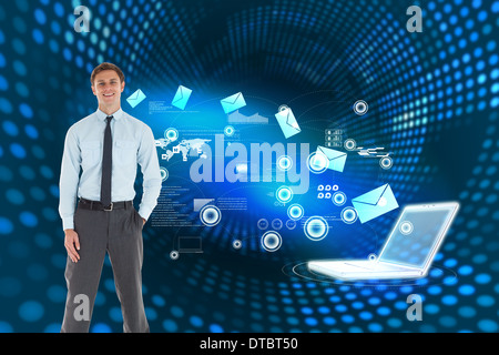 Composite image of smiling businessman standing with hand in pocket - Stock Photo