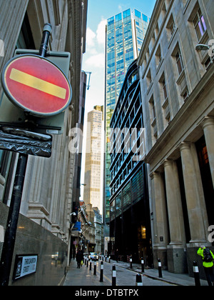 Stree in the City of London showing Tower 42 and the Stock Exchange Tower in distance, London, England, United Kingdom - Stock Photo
