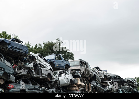 Crushed cars in scrap yard UK - Stock Photo