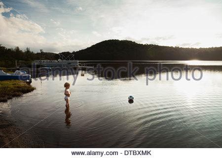 Baby boy challenged to retrieve ball, Lake Pleasant, NY, USA - Stock Photo