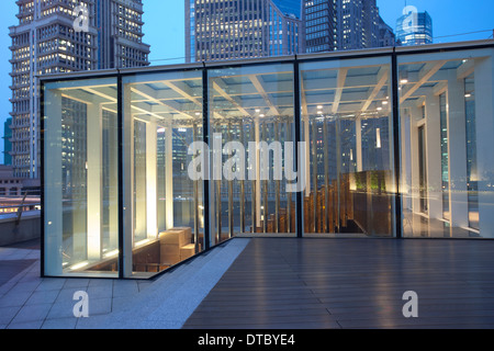 wooden platform rounded by office building,lujiazui ,shanghai - Stock Photo