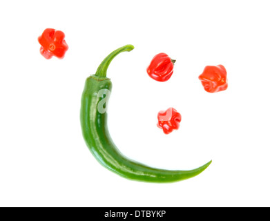 Two different kinds of peppers as the moon and the stars against white background - Stock Photo