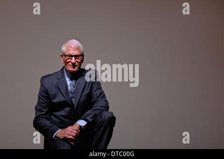 Studio portrait of cool senior man in suit - Stock Photo