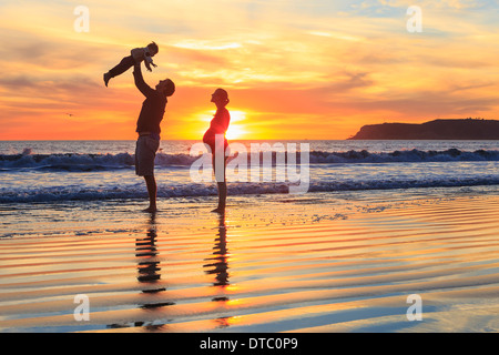 Family with toddler son playing on beach, San Diego, California, USA - Stock Photo