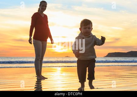 Mother and toddler son playing on beach, San Diego, California, USA - Stock Photo