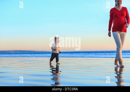 Mother and toddler son having fun on beach, San Diego, California, USA - Stock Photo