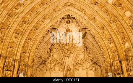 TOLEDO, SPAIN - MARCH 8, 2013: Detail of nightly south gothic portal of Cathedral Primada Santa Maria de Toledo. - Stock Photo