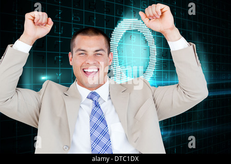 Composite image of successful businessman punching the air - Stock Photo