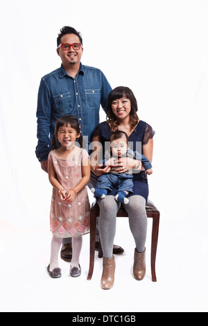 Family portrait of mid adult couple with daughter and baby boy - Stock Photo