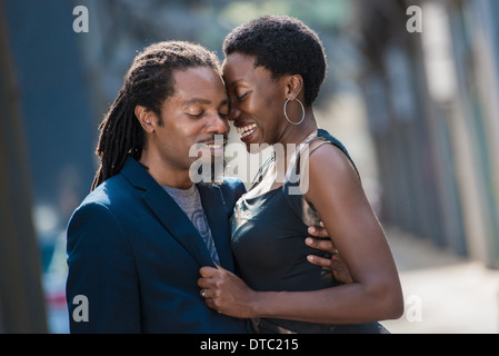 Couple embracing on street - Stock Photo